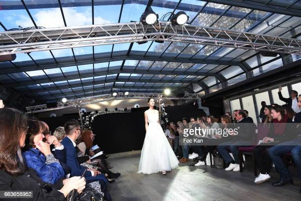 A model walks the runway during Cymbeline Wedding Dresses Show at Yacht de Paris on April 1 2017 in Paris France