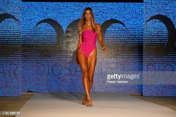 A model walks the runway during Diosa Mar At Miami Swim Week 2019 Produced By Planet Fashion at Kimpton Surfcomber Hotel on July 11 2019 in Miami...