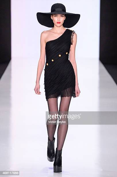 A model walks the runway during Elena Bryntsalova AutumnWinter 201516 show as part of MercedesBenz Fashion Week Russia Day 3 on March 28 2015 in...