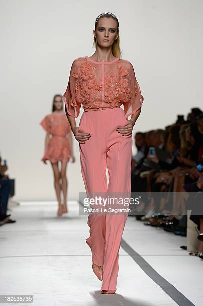 A model walks the runway during Elie Saab show as part of the Paris Fashion Week Womenswear Spring/Summer 2014 at Espace Ephemere Tuileries on...