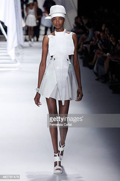 A model walks the runway during Ellus show at Sao Paulo Fashion Week Summer 2014/2015 at Parque Candido Portinari on April 4 2014 in Sao Paulo Brazil