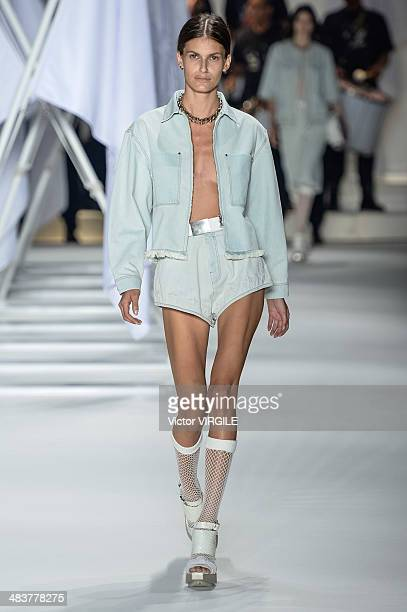 A model walks the runway during Ellus show at Sao Paulo Fashion Week Spring Summer 2014/2015 at Parque Candido Portinari on April 4 2014 in Sao Paulo...