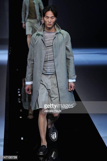 Model walks the runway during Emporio Armani show as part of Milan Fashion Week Menswear Spring/Summer 2013 on June 25, 2012 in Milan, Italy.