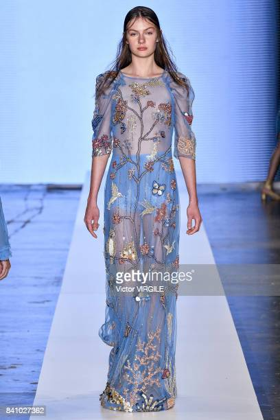 A model walks the runway during Fabiana Milazzo fashion show as part of Sao Paulo N44 Fashion Week Spring/Summer 2018 on August 28 2017 in Sao Paulo...