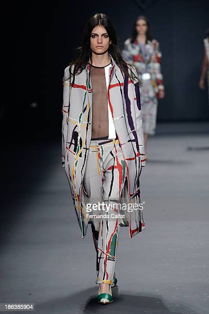 A model walks the runway during Forum show at Sao Paulo Fashion Week Winter 2014 on October 30 2013 in Sao Paulo Brazil