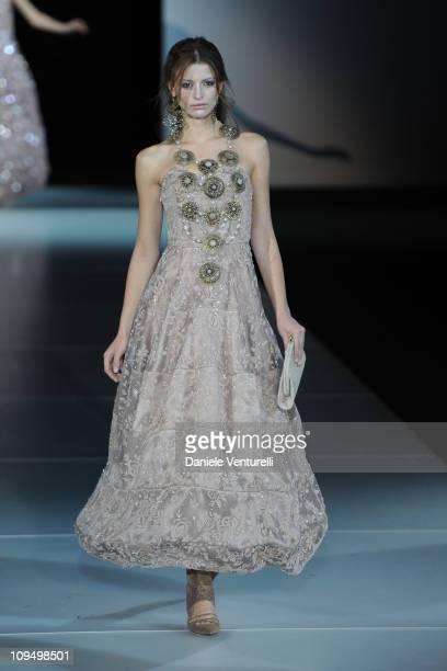 Model walks the runway during Giorgio Armani fashion show as part of Milan Fashion Week Womenswear Autumn/Winter 2011 on February 28, 2011 in Milan,...