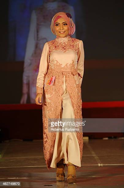 A model walks the runway during Indonesia Moslem Fashion Expo show on February 4 2015 in Surabaya Indonesia Indonesia hopes to become the 'Paris of...