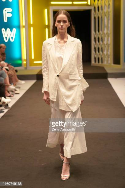 Model walks the runway during 'International Fashion: On Parade – Yue Fashion Prevail In the World' show as part of Hong Kong Fashion Week...