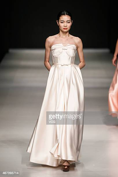 Model walks the runway during ISOKE LIU show as part of the Shenzhen Fashion Week A/W 2015 at OCT Harbour on March 24 2015 in Shenzhen Guangdong...