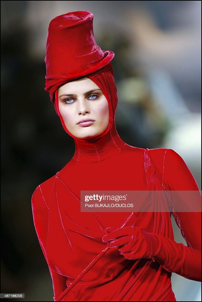 A model walks the runway during Jean Paul Gaultier show as part of Paris Fashion Week Haute Couture Fall/Winter 2004 in Paris, France on July 9, 2003.