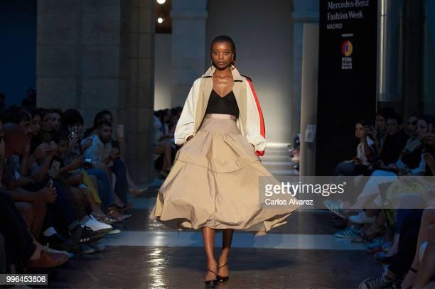 A model walks the runway during Juan Vidal show at Mercedes Benz Fashion Week Madrid Spring/ Summer 2019 on July 11 2018 in Madrid Spain