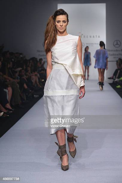 A model walks the runway during Julia y Renata show at MercedesBenz Fashion Week México Spring/Summer 2015 at Campo Marte on October 2 2014 in Mexico...