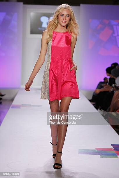 A model walks the runway during Just Dance with Boy Meets Girl show at the STYLE360 Fashion Pavilion in Chelsea on September 12 2013 in New York City