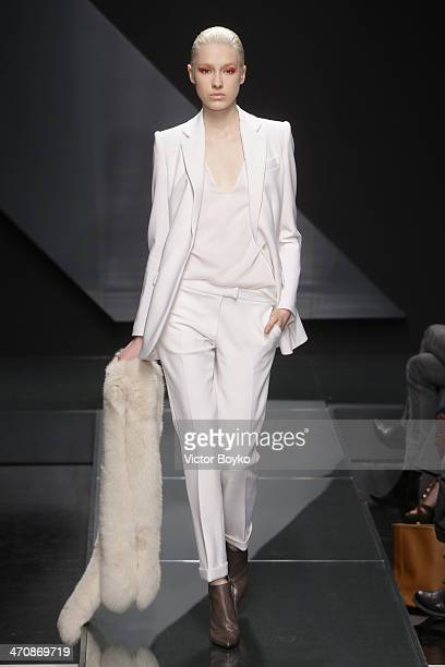 Model walks the runway during Krizia show as part of Milan Fashion Week Womenswear Autumn/Winter 2014 on February 20, 2014 in Milan, Italy.