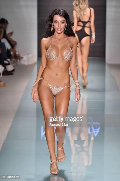 A model walks the runway during LILIANA MONTOYA Runway at FUNKSHION Swim Fashion Week at Funkshion Tent on July 23 2017 in Miami Beach Florida