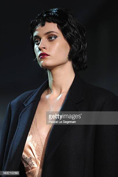 A model walks the runway during Louis Vuitton Fall/Winter 2013 ReadytoWear show as part of Paris Fashion Week on March 6 2013 in Paris France