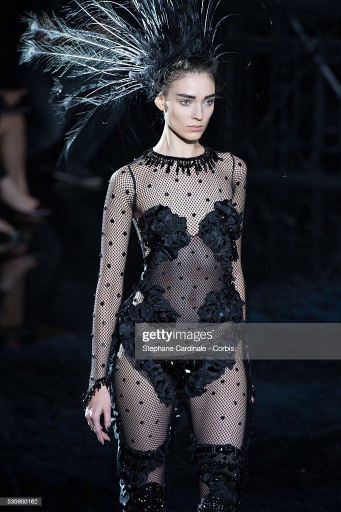 A model walks the runway during Louis Vuitton show at 'Cour Carre du Louvre', as part of the Paris Fashion Week Womenswear Spring/Summer 2014, in Paris.