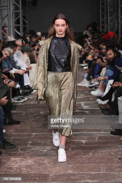Model walks the runway during Lust fashion show at Mercedes Benz Fashion Week Mexico 2018 at Antiguo Colegio de San Ildefonso on October 11, 2018 in...