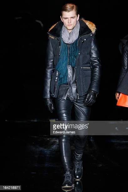 A model walks the runway during Mackage at David Pecaut Square on March 20 2013 in Toronto Canada