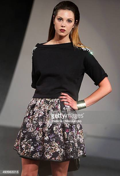 A model walks the runway during Mangano Fashion Show on May 26 2014 in Milan Italy