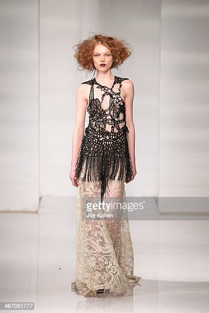 Model walks the runway during Manufacture New York's Design Incubator at Launch NYC on February 5, 2014 in New York City.