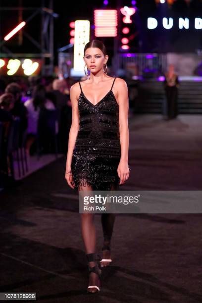 A model walks the runway during Michael Muller's HEAVEN presented by The Art of Elysium on January 5 2019 in Los Angeles California