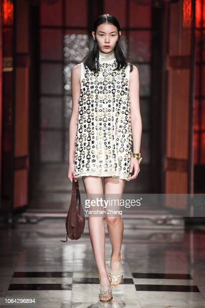 A model walks the runway during Miu Miu Cruise 2019 Fashion Show at Hotel Waldorf Astoria on November 22 2018 in Shanghai China