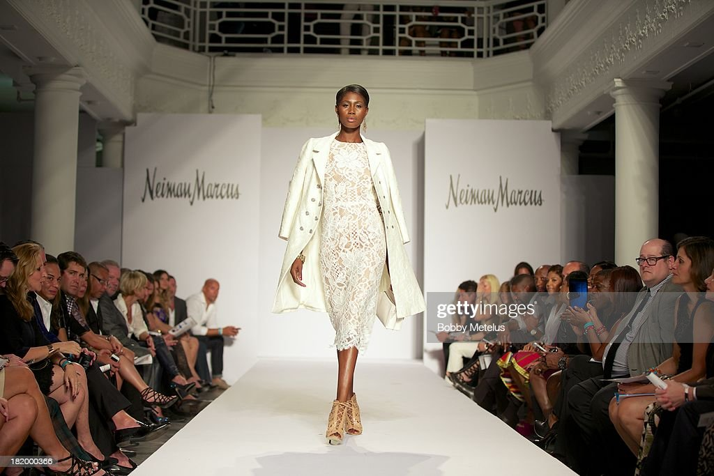 A model walks the runway during NBA Champion and Miami Heat Dwyane Wade's Night On The RunWade to benefit Wade's World Foundation on September 26, 2013 in Miami, Florida.