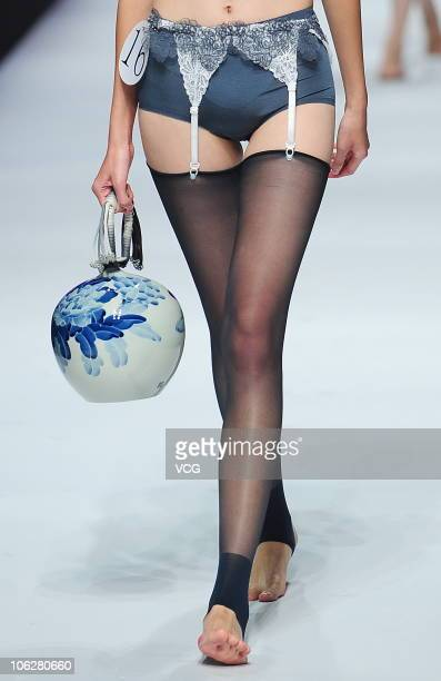 A model walks the runway during Ordifen Innovative Design Contest on the fifth day of China Fashion Week Spring/Summer 2011 on October 28 2010 in...