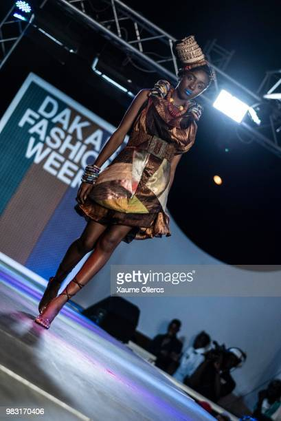 A model walks the runway during Ousmou Sy show on last day of the Dakar Fashion Week at the working class suburb of Keur Massar on June 24 2018 in...