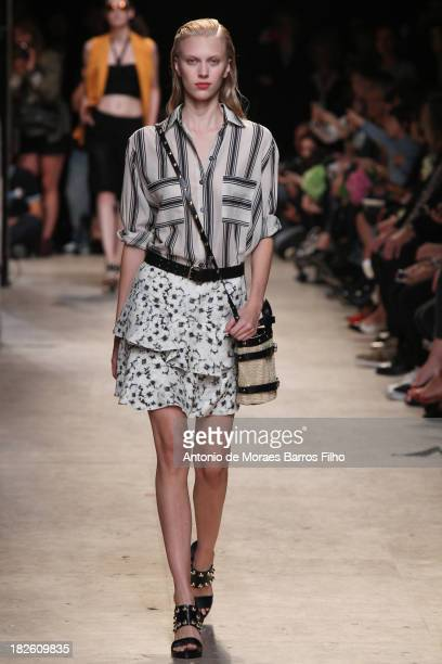 A model walks the runway during Paul Joe show as part of the Paris Fashion Week Womenswear Spring/Summer 2014 on October 1 2013 in Paris France