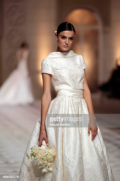 A model walks the runway during Pronovia's 50th anniversary bridal fashion show during 'Barcelona Bridal Week 2014' on May 9 2014 in Barcelona Spain