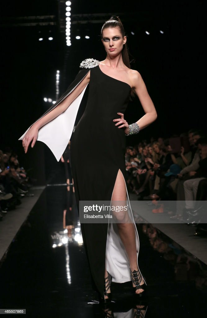 A model walks the runway during Raffaella Frasca S/S 2014 Italian Haute Couture colletion fashion show as part of AltaRoma AltaModa Fashion Week at Santo Spirito In Sassia on January 26, 2014 in Rome, Italy.