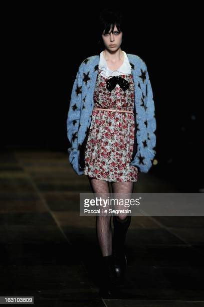 A model walks the runway during Saint Laurent Fall/Winter 2013 ReadytoWear show as part of Paris Fashion Week on March 4 2013 in Paris France