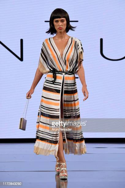 Model walks the runway during SANGUEL at New York Fashion Week Powered by Art Hearts Fashion at The Angel Orensanz Foundation on September 06, 2019...