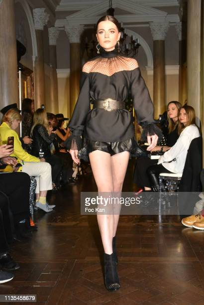 A model walks the runway during Stevens Ishay Fashion Show at 3 avenue Emile Acolas on March 12 2019 in Paris France