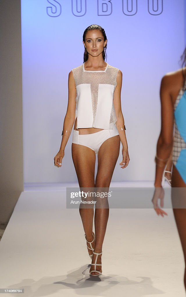 A model walks the runway during Suboo - Mercedes-Benz Fashion Week Swim 2014 at Raleigh Hotel on July 19, 2013 in Miami Beach, Florida.