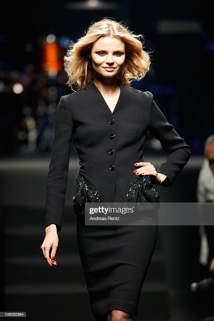 A model walks the runway during the 2012 amfAR's Cinema Against AIDS during the 65th Annual Cannes Film Festival at Hotel Du Cap on May 24, 2012 in Cap D'Antibes, France.