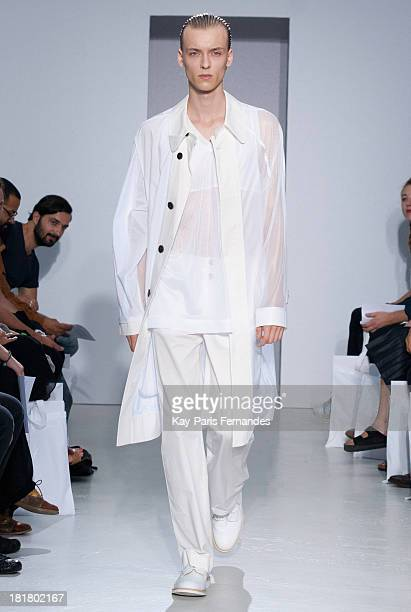 A model walks the runway during the 22/4 Hommes Femmes show as part of the Paris Fashion Week Womenswear Spring/Summer 2014 on September 25 2013 in...