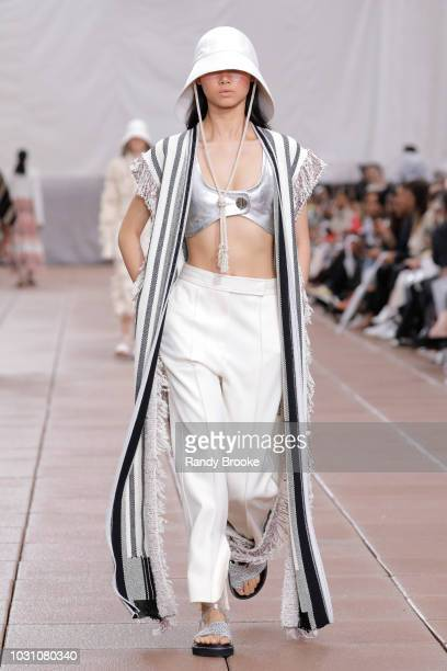 A model walks the runway during the 31 Phillip Lim fashion show Spring 2019 in September 2018 New York Fashion Week at New Design High School on...