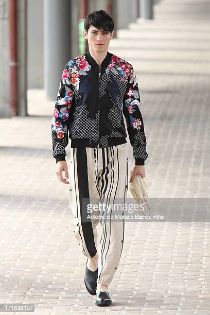 A model walks the runway during the 31 Phillip Lim Menswear Spring/Summer 2014 Show As Part Of The Paris Fashion Week on June 27 2013 in Paris France