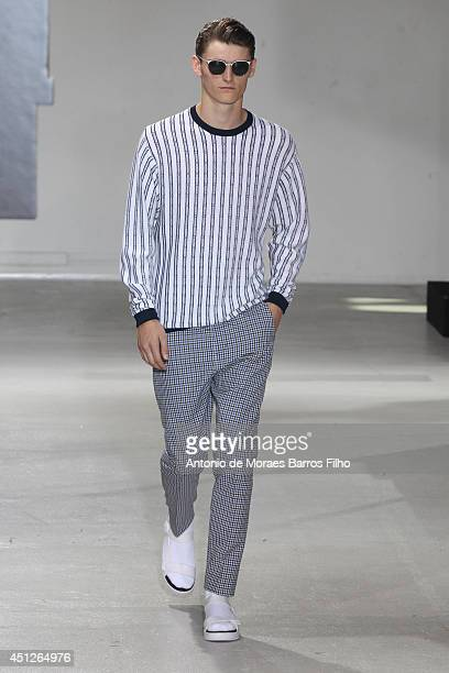 Model walks the runway during the 3.1 Phillip Lim show as part of the Paris Fashion Week Menswear Spring/Summer 2015 on June 26, 2014 in Paris,...