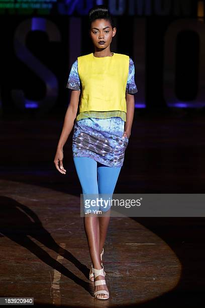 A model walks the runway during the 3rd Annual United Colors Of Fashion Gala at Lexington Avenue Armory on October 9 2013 in New York City