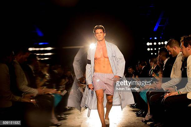 A model walks the runway during the 7th Annual amfAR Inspiration Gala at Skylight at Moynihan Station on June 9 2016 in New York City
