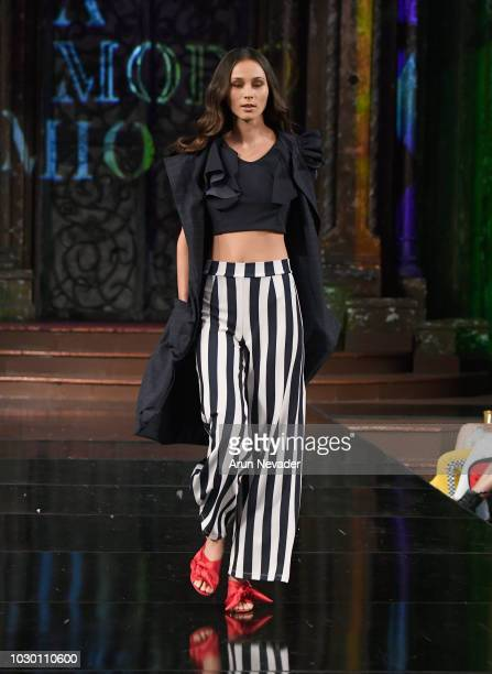 A model walks the runway during the A MODO MIO show at New York Fashion Week Powered By Art Hearts Fashion at The Angel Orensanz Foundation on...