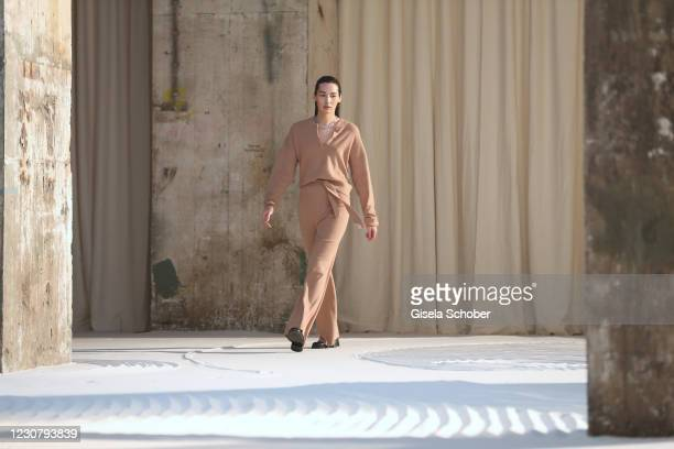 Model walks the runway during the About You Fashion Week, AYFW, LeGer by LenaGercke show production at Kraftwerk on January 24, 2021 in Berlin,...