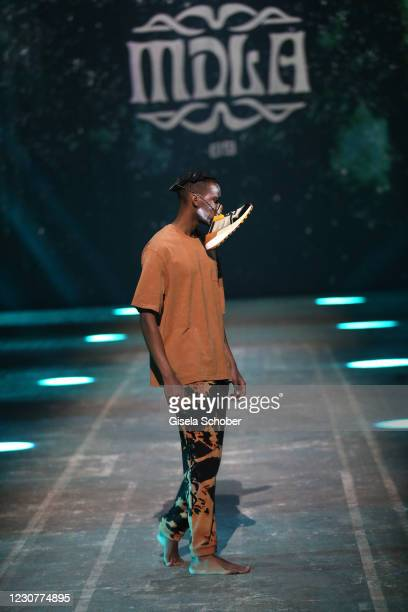 Model walks the runway during the ABOUT YOU Fashion Week, AYFW, MDLA show production at Kraftwerk on January 23, 2021 in Berlin, Germany.