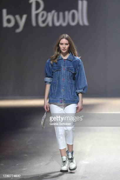 Model walks the runway during the ABOUT YOU Fashion Week, AYFW, Perwoll show production at Kraftwerk on January 23, 2021 in Berlin, Germany.