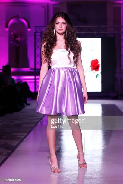 A model walks the runway during the AC Alyssa Casa show at the Cosmopolitan NYFW FW20 fashion show during New York Fashion Week at Lotte New York...
