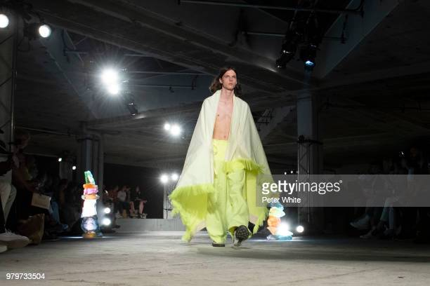 A model walks the runway during the Acne Studio Menswear Spring/Summer 2019 show as part of Paris Fashion Week on June 20 2018 in Paris France